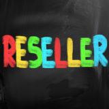 """""""Reseller"""" in bunten Farben vor einem schwarzen Hintergrund."""